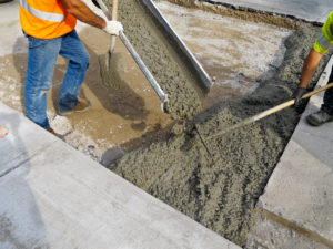 Worker Pouring Concrete_shutterstock_82641973